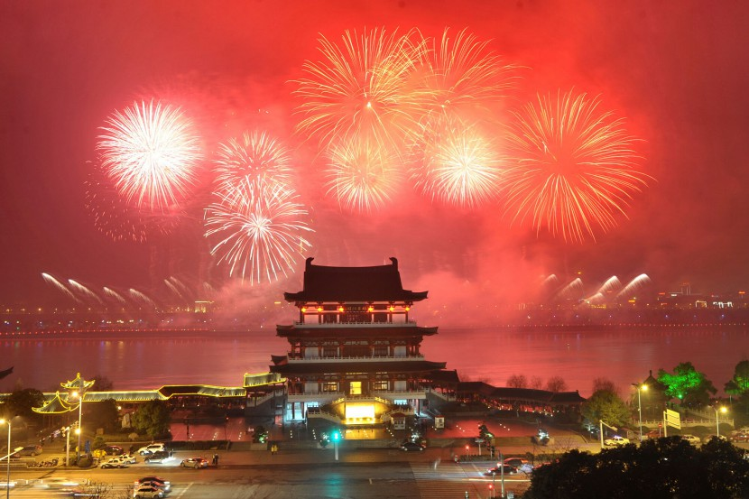 Fireworks over a building on Chinese New Year