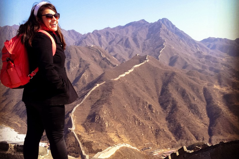 CiCi standing over the Great Wall of China in the background