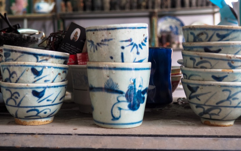 A selection of old Chinese pottery on a shelf