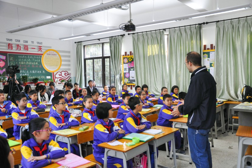 Jack at the front of class teaching in China