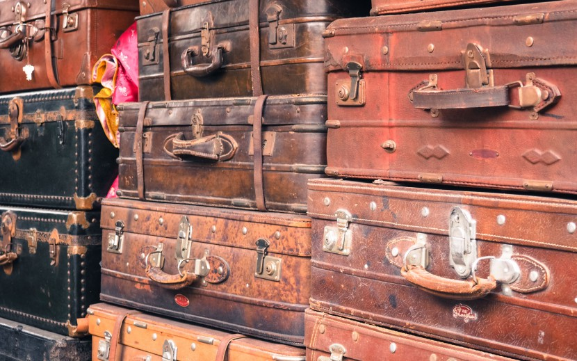 Old suitcases piled on teach other