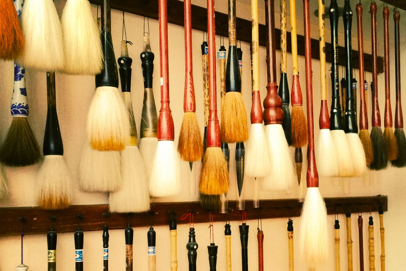 Paint brushes hanging on a wall